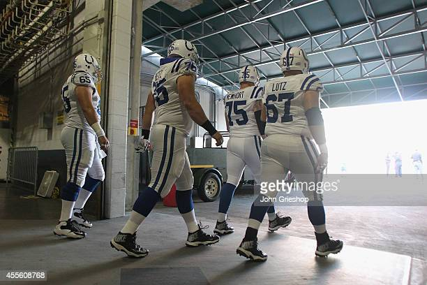 Nnamdi Obukwelu and Jack Mewhort and Joe Reitz of the Indianapolis Colts take the field before their game against the Cincinnati Bengals at Paul...