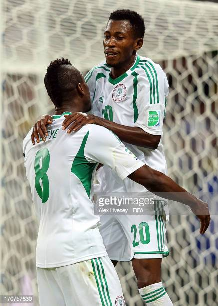 Nnamdi Oduamadi of Nigeria celebrates scoring his team's fifth goal with teammate Brown Ideye during the FIFA Confederations Cup Brazil 2013 Group B...