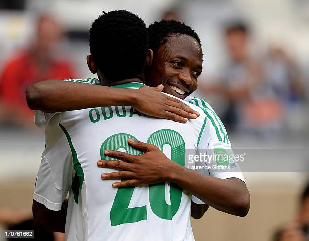 Nnamdi Oduamadi of Nigeria celebrates with teammate Ahmed Musa after scoring his team's second goal during the FIFA Confederations Cup Brazil 2013...