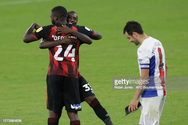 Nnamdi Ofoborh and Jordan Zemura of Bournemouth celebrate after Luka Milivojevic of Crystal Palace has his second penalty saved losing tie 11-10...