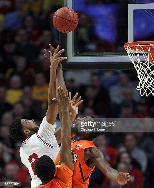 Nnanna Egwu of Illinois right and Christian Watford of Indiana stretch for the ball in the first half during the quarterfinals of the 2013 Big Ten...