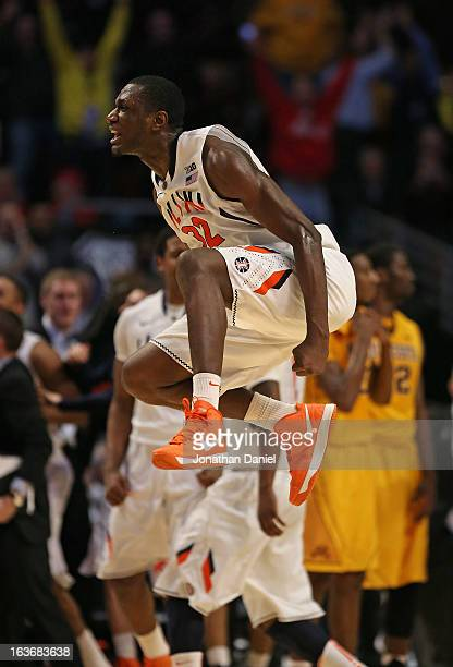 Nnanna Egwu of the Illinois Fighting Illini reacts after defeating the Minnesota Golden Gophers during a quarterfinal game of the Big Ten Basketball...