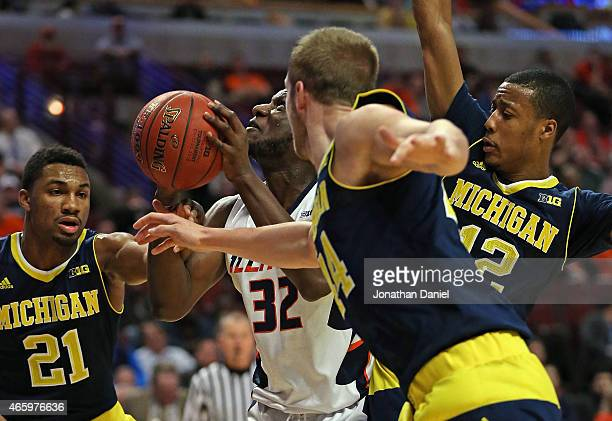 Nnanna Egwu of the Illinois Fighting Illini ries to get off a shot under pressure from Zak Irvin, Max Bielfeldt and Muhammad-Ali Abdur-Rahkman of the...