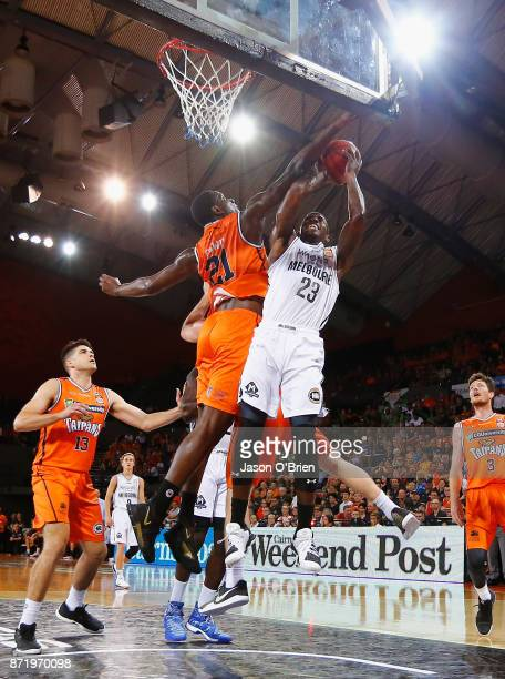 Nnanna Egwu of the Taipans denies Casey Prather a basket during the round six NBL match between the Cairns Taipans and Melbourne United at Cairns...