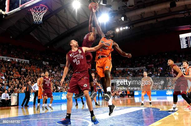 Nnanna Egwu of the Taipans is pressured by the Bullets defence during the round 10 NBL match between the Cairns Taipans and the Brisbane Bullets at...