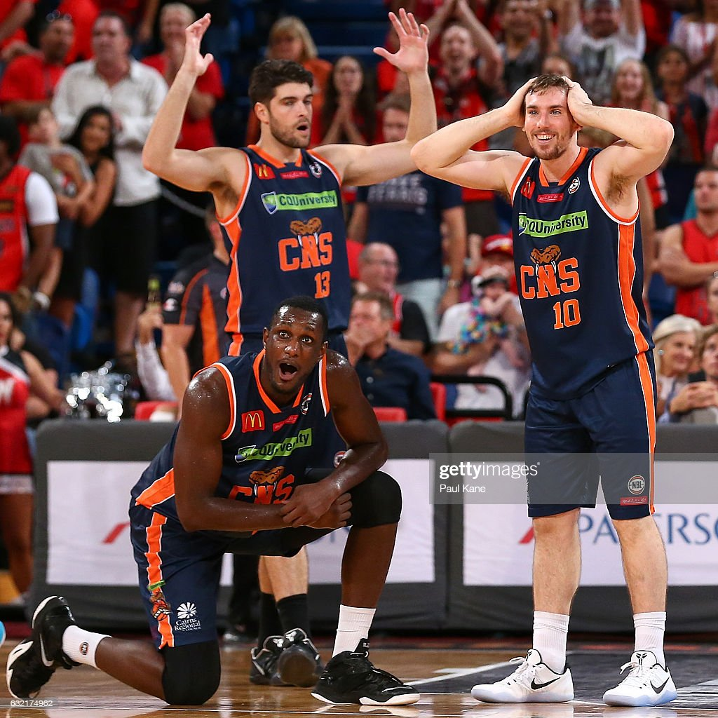 Nnanna Egwu; Stephen Weigh and Mitch McCarron of the Taipans react after Bryce Cotton of the Wildcats was fouled in the dying seconds of the game during the round 16 NBL match between the Perth Wildcats and the Cairns Taipans at Perth Arena on January 20, 2017 in Perth, Australia.
