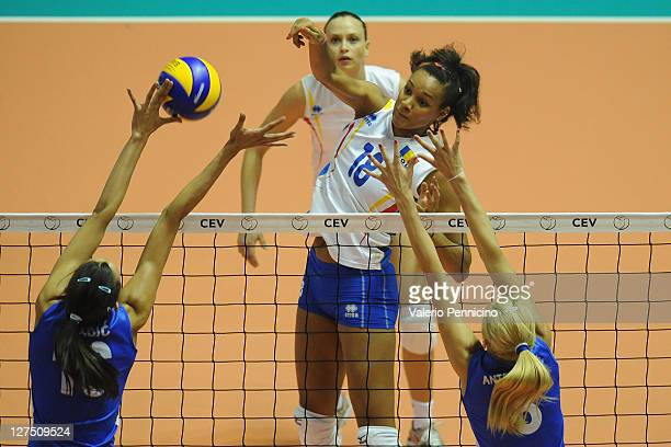 Nneka Obia Onyejekwe of Romania smashes as Ana Antonijevic and Milena Rasic of Serbia block during the women's Volleyball European Championship match...
