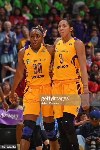 Nneka Ogwumike and Candace Parker of the Los Angeles Sparks hug each other and walk off the court during the game against the Chicago Sky on July 20...