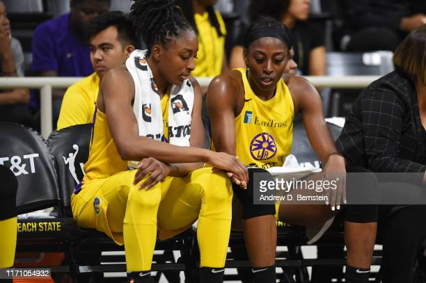 Nneka Ogwumike and Chiney Ogwumike of the Los Angeles Sparks look on against the Connecticut Sun during Game Three of the 2019 WNBA Semifinals on...