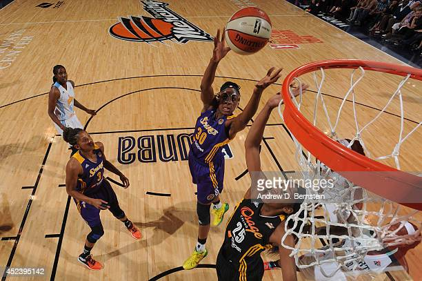 Nneka Ogwumike and Glory Johnson of the Western Conference AllStars go up for a rebound during the 2014 Boost Mobile WNBA AllStar Game on July 19...