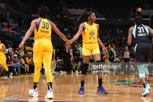 Nneka Ogwumike highfives Chiney Ogwumike of the Los Angeles Sparks against the New York Liberty on June 15 2019 at the Staples Center in Los Angeles...