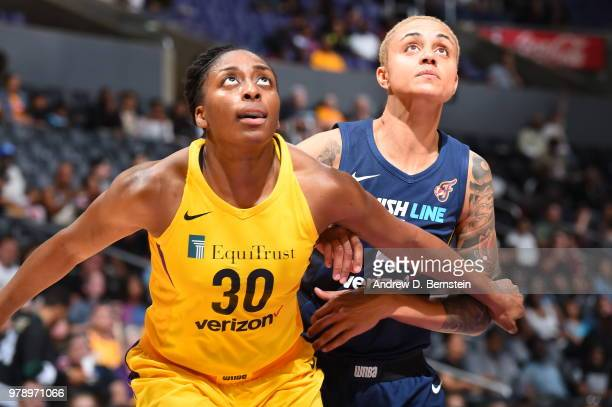 Nneka Ogwumike of the Los Angeles Sparks and Candice Dupree of the Indiana Fever wait for the ball on June 19 2018 at STAPLES Center in Los Angeles...