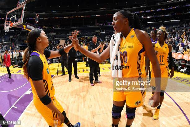 Nneka Ogwumike of the Los Angeles Sparks and Odyssey Sims of the Los Angeles Sparks high five each other after the game against the Phoenix Mercury...