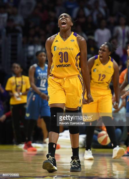 Nneka Ogwumike of the Los Angeles Sparks celebrates after forcing a turnover against Minnesota Lynx during the second half of Game Three of WNBA...