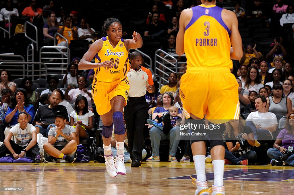 Nneka Ogwumike #30 of the Los Angeles Sparks celebrates against the Phoenix Mercury at Staples Center on September 15, 2013 in Los Angeles, California.