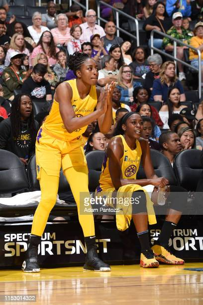 Nneka Ogwumike of the Los Angeles Sparks cheers on team during the game against the Chicago Sky on June 30 2019 at the Staples Center in Los Angeles...
