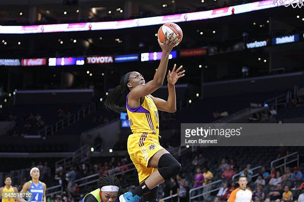 Nneka Ogwumike of the Los Angeles Sparks goes to the basket for two against the Dallas Wings during a WNBA basketball game at Staples Center on June...