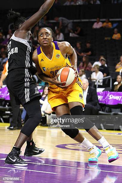 Nneka Ogwumike of the Los Angeles Sparks handle the ball against Sophia YoungMalcom of the San Antonio Stars in a WNBA game at Staples Center on July...