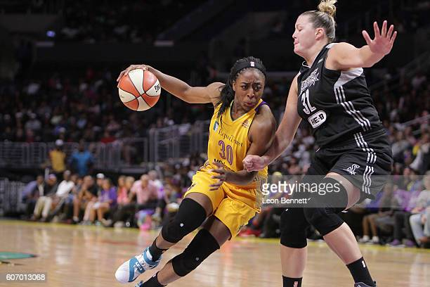 Nneka Ogwumike of the Los Angeles Sparks handles the ball against Jayne AppelMarinelli of the San Antonio Stars during a WNBA basketball game at...