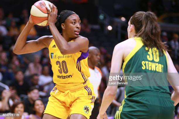 Nneka Ogwumike of the Los Angeles Sparks handles the ball against Breanna Stewart of the Seattle Storm during a WNBA basketball game at Staples...