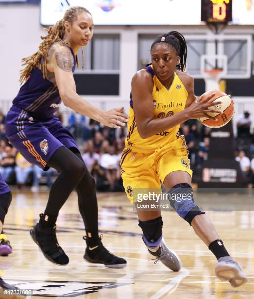 Nneka Ogwumike of the Los Angeles Sparks handles the ball against Brittney Griner of the Phoenix Mercury in game two of the Semifinals during the...
