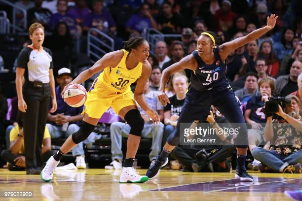 Nneka Ogwumike of the Los Angeles Sparks handles the ball against Kayla Alexander of the Indiana Fever during a WNBA basketball game at Staples...