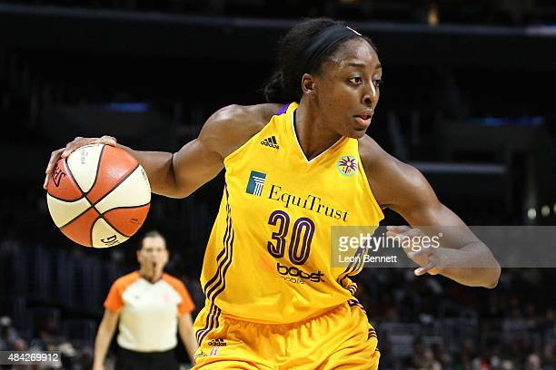 Nneka Ogwumike of the Los Angeles Sparks handles the ball against the Chicago Sky in a WNBA game at Staples Center on August 16 2015 in Los Angeles...