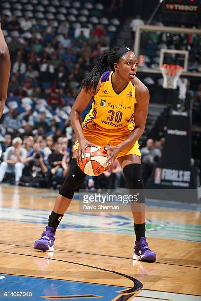 Nneka Ogwumike of the Los Angeles Sparks handles the ball against the Minnesota Lynx during Game Two of the 2016 WNBA Finals on October 11 2016 at...