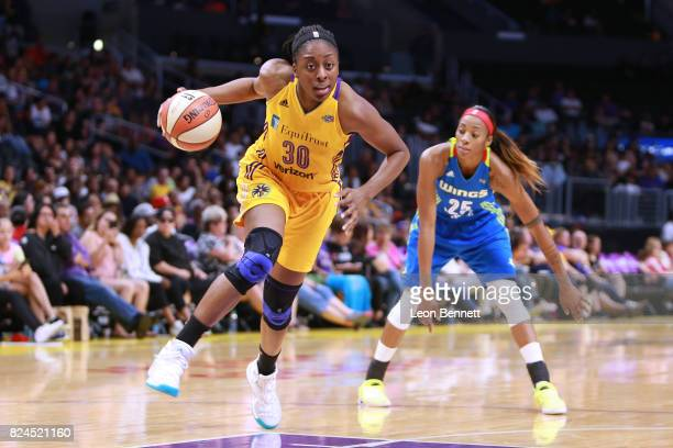 Nneka Ogwumike of the Los Angeles Sparks handles the ball against the Dallas Wings during a WNBA basketball game at Staples Center on July 30 2017 in...