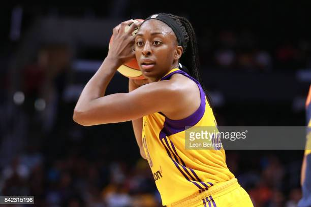 Nneka Ogwumike of the Los Angeles Sparks handles the ball against the Connecticut Sun during a WNBA basketball game at Staples Center on September 3...