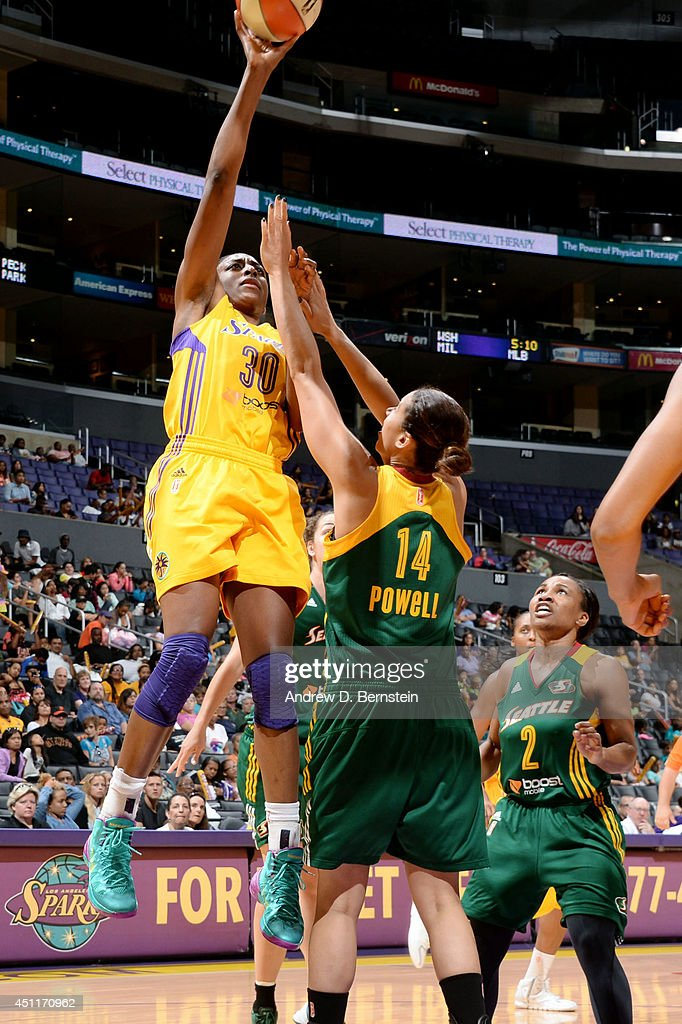 Nneka Ogwumike #30 of the Los Angeles Sparks shoots against Nicole Powell #14 of the Seattle Storm at STAPLES Center on June 24, 2014 in Los Angeles, California.