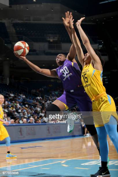 Jantel Lavender of the Los Angeles Sparks goes up for a rebound against the Chicago Sky on June 17 2018 at the Allstate Arena in Rosemont Illinois...