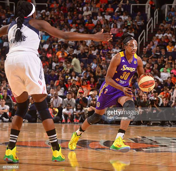 Nneka Ogwumike of the Western Conference AllStars dribbles against Chiney Ogwumike of the Eastern Conference AllStars during the 2014 Boost Mobile...