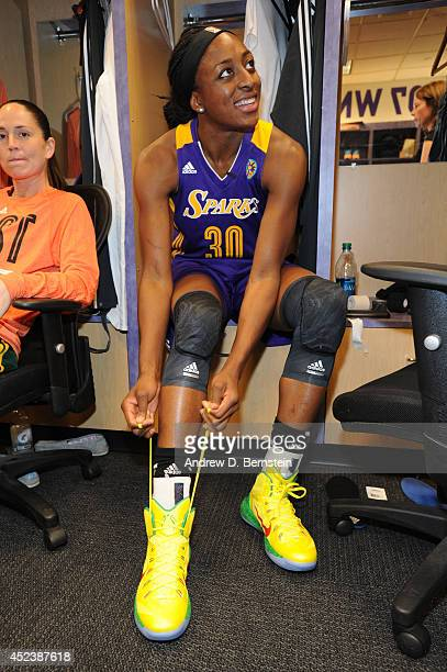 Nneka Ogwumike of the Western Conference AllStars ties her sneakers in the locker room before the 2014 Boost Mobile WNBA AllStar Game on July 19 2014...