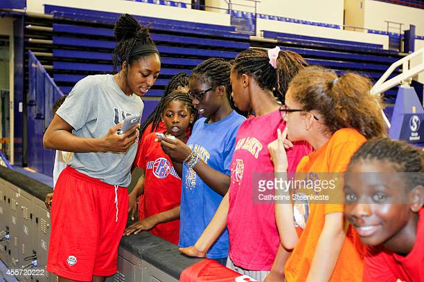 Nnemkadi Ogwumike of the USA Women's National Team talks to the kids from PB18 and Paris Lady Basket after practice at Stade de Coubertin on...