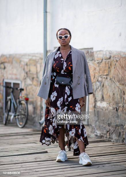 Nnenna Echem wearing dress with floral print seen outside byTiMo during Oslo Runway SS19 on August 14 2018 in Oslo Norway