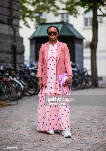 Nnenna Echem wearing pink dress with dots print blazer jacket is seen outside Cathrine Hammel during Oslo Runway SS19 on August 14 2018 in Oslo Norway