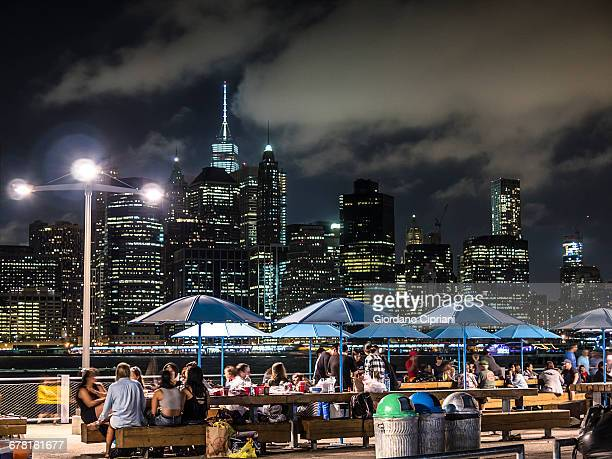 nnight view of brooklyn bridge park greeway - cipriani manhattan stock pictures, royalty-free photos & images