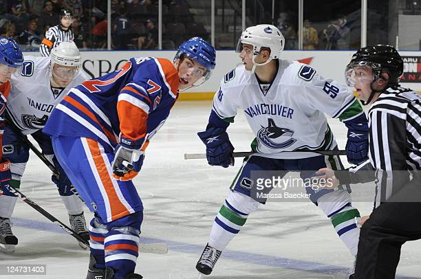 No. 1 draft pick, Ryan Nugent-Hopkins of the Edmonton Oilers faces off against Alex Friesen of the Vancouver Canucks during the 2001 Vancouver...