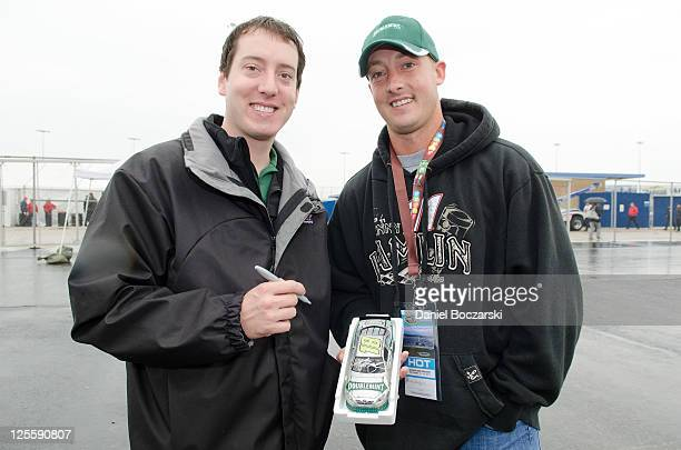 No 18 Doublemint driver Kyle Busch poses with his look alike Micky Roseberry of Cedar Point Iowa at Chicagoland Speedway on September 18 2011 in...