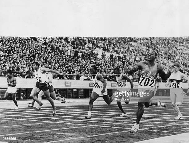 No 702 Robert Hayes of the USA winning the final of the men's 100 metres in Tokyo to set up a new Olympic record of 100 Enrique Figuerola Camue of...