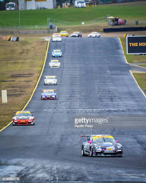 No 91 Jaxon Evans leads the first lap of the Carrera Cups Rennsport ProAm 34 lap contest during final day of the Porsche Rennsport Australia Motor...