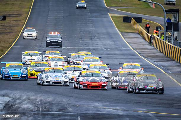 No 91 Jaxon Evans leads the start of the Carrera Cups Rennsport ProAm 34 lap contest during final day of the Porsche Rennsport Australia Motor Racing...