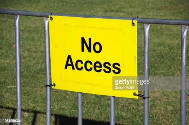 'no access' sign on a steel barricade fence - forbidden stock pictures, royalty-free photos & images