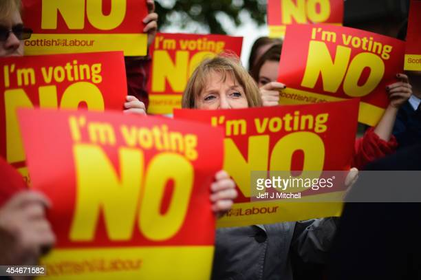 'No' activists gather near to where Scottish Labour Leader Johann Lamont is campaigning ahead of the Scottish Referendum targeting SNP voters in...