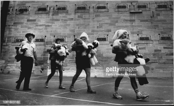 No angels and no elves Warren Bampton Robert McCann and Don Lambert escorted by prison officer Ray Anderson deliver another load of finished toys at...