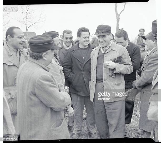 No Cigars Monterossi Italy Italian movie director Roberto Rossellini is surrounded by congratulating members of his film crew after the birth of a...