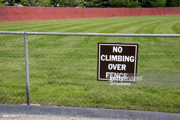 A no climbing over fence sign on the baseball fields at Moyer Sports Complex