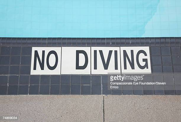 "no diving sign on floor at swimming pool - ""compassionate eye"" fotografías e imágenes de stock"