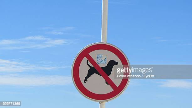 No Dogs Allowed Sign Against Sky
